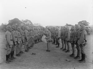 Portuguese troops in training, at Horsham, Sussex. Gas mask drill