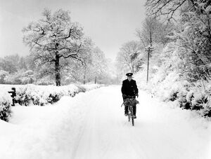 Postman cycling through snow in Bough Beech, Kent. 28th December 1962