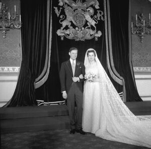 Princess Alexandra of Kent wearing a gown of magnolia tinted lace, embroided with acorns