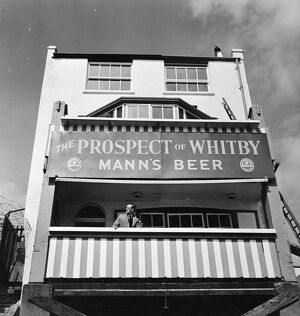 Pub and large sign for The Prospect of Whitby, Wapping, London, England 1951