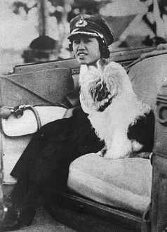 Queen as Colonel of the girl guides The Queen of Siam motoring to a rally of girl