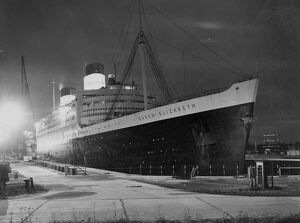 The Queen Elizabeth in dry dock. After hold-up at 12 hours due to unfavourable weather
