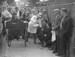 Queue for opening of Wimbledon. Refreshment from 'mobile cafe'