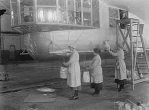 R36 Ready for launching at Inchinnan Woman workers placing ballast bags on the airship 19