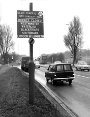 An RAC sign warning of bridge closures on the day of the State Funeral of Sir Winston