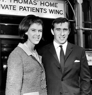 Racing driver Jackie Stewart, injured in the Belgiam Grand Prix, left St Thomas's