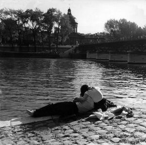 Romantic couple on the banks of the Seine , Paris in 1950s love couple romance romantic