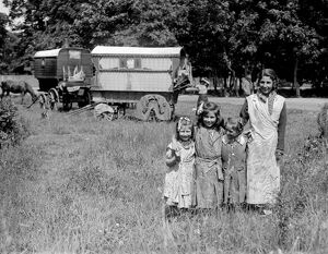 Romany gypsy girls posing outside their caravans on Epsom Downs during the Epsom