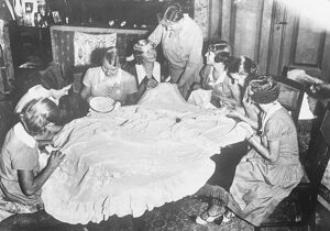 Royal bride ' s friends prepare her trousseau. The wedding dress and trousseau