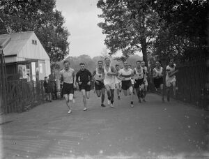 Runners from the Dartford Harriers during a road race. 25 October 1935