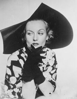 Scalloped Millinery. Carole Lombard, the Hollywood film actress, wearing a new