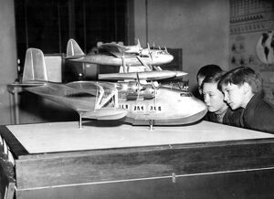 Schoolboys examine a model of the Mayo trans Atlantic flying boat at the Imperial