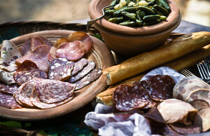 Selection of Italian cold, cired meats and salamis, with gherkins and French bread