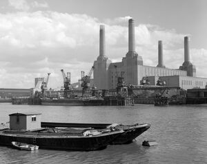 A ship unloading at the pier at Battersea Power Station, seen from across the Thames