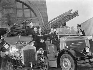 Sidcup 's new and old fire engines side by side.. 19 April 1937