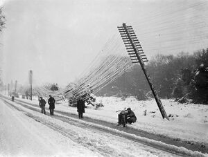 Snow havoc in Southern England. Telegraph poles blown over. The worst havoc of