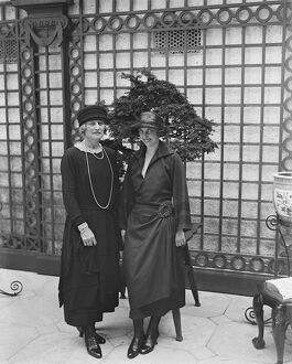 Society garden party at Lady Hulton 's residence. Lady Arthur Pearson ( left )