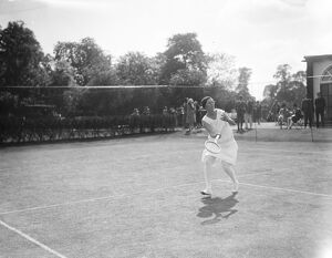 South African women tennis players practice at Hurlingham. Mrs Peacock in play