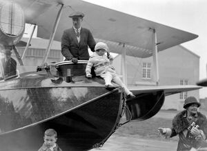 Squadron Leader Archibald Stuart MacLaren and his daughter standing in the Vickers