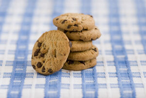 Stack of chocolate chip cookies from supermarket credit: Marie-Louise Avery /