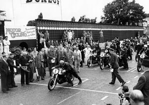 The start of the Senior TT trophy race at the Isle of Man. H L Daniell, is first to start