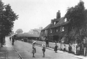 A street scene from 1907 of Great Chart, Ashford, Kent, children playing in the