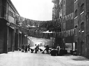 Sugar bags hanging out to dry, North Quay, West India Docks, 1900