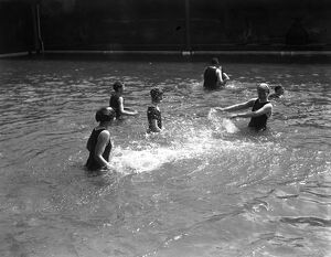 Swimmers in the open air swimming pool at Westcliff - on - Sea, Essex