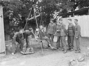 Territorial Army recruits at camp in Chichester, Sussex. Weighing machine. 1939