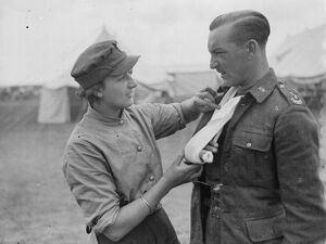 Territorial Army recruits at camp in Lympne, Kent. Treating an injury