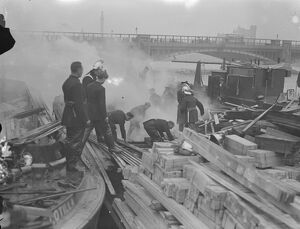 Timber barge on fire at Vauxhall , London
