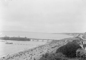 A view over Bournemouth showing the beach and pier. 1925
