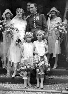 The wedding of Captain A.C. Giles, ( Royal Warwickshire Regiment ) to Miss Evelyn Drewe