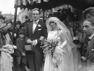 Wedding. Squadron Leader Wyndham Brookes Farrington and Miss V M Neville were married