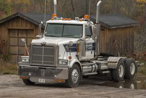 A white 6 x4 Western star tractor unit parked up at a rural Ontario timber yard
