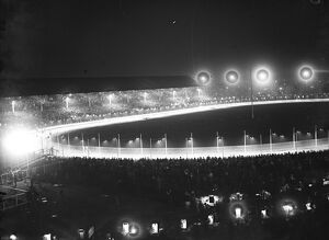 The White City at night, where illuminated greyhound racing attracts average crowd of 75