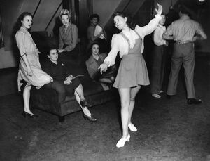 Windmill girls in 1946 dance / dancing / party season / celebration / happy vintage