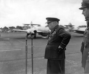 Winston Churchill in Air Commodore's uniform stands hand on hip as he addresses 615