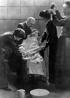 A woman Suffragette prisoner being force fed with a tube 1912