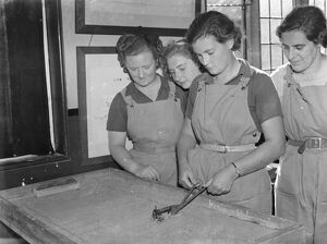 Women 's Land Army in training in Wye, Kent. Here the Land Girls are being given