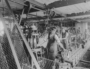 Workers bottle washing in a brewery London, England. undated