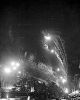 Workmen are now labouring day and night to repair the liner Aquitania in the new