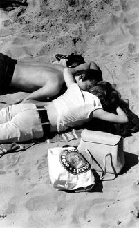 Young couple on the beach.. 1960's love couple romance romantic for valentines